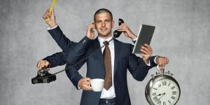 Blog image man answering phone and multitasking