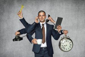 Blog image man answering phone and multitasking